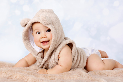 Happy little baby crawling in diaper